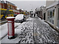 SZ0893 : Winton: snow-spattered postbox by Chris Downer