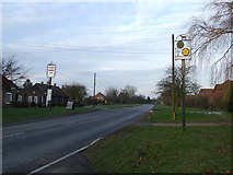 TM0652 : Village Of The Year Sign by Keith Evans