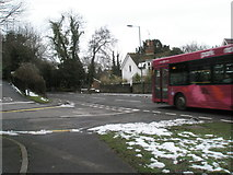 SU9948 : Bus passing the junction of Portsmouth and Guildown Roads by Basher Eyre