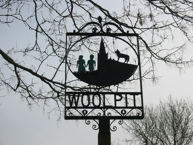 "The ""green children"" of Woolpit on the village sign"