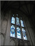 SU4829 : Unusual blue and purple stained glass window on the north wall at Winchester Cathedral by Basher Eyre