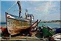 B6815 : Aranmore Island - Fishing boat needing some TLC by Joseph Mischyshyn