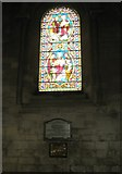 SU3521 : Memorials below a stained glass window at Romsey Abbey by Basher Eyre
