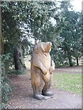 TQ1776 : Wood carving of a bear in Kew Gardens by pam fray
