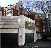 TQ2977 : Disused Garage by PAUL FARMER