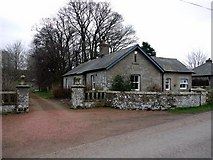 NT9911 : East lodge at Alnham House by Andrew Curtis
