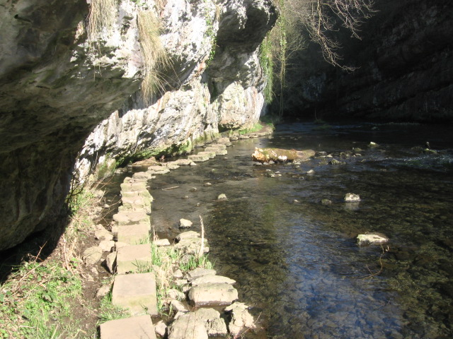 Stepping stone footpath under cliffs in Chee Dale