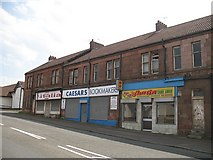 NS7061 : Shops, Old Edinburgh Road by Richard Webb