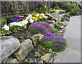 NU1241 : Floral display, the Gospel Gardens, Holy Island by Christine Matthews