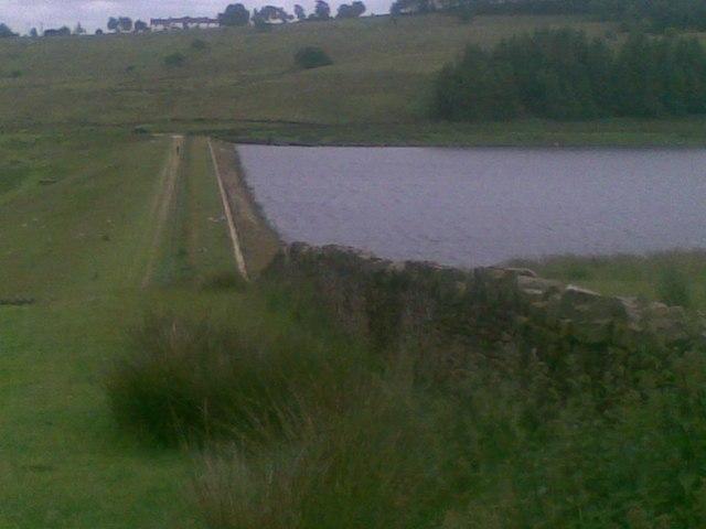 The dam wall of Dean Clough reservoir.