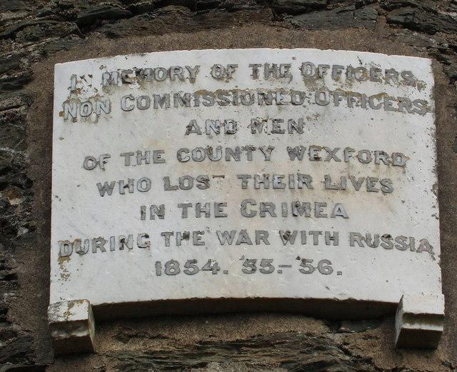 Plaque on round tower memorial, Irish National Heritage Park