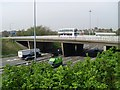 NS6366 : Cumbernauld Road crosses the M8 by Stephen Sweeney