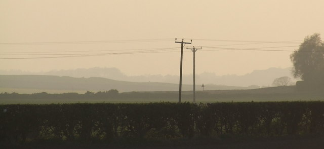A hazy view across fields between Panbride and Carlogie