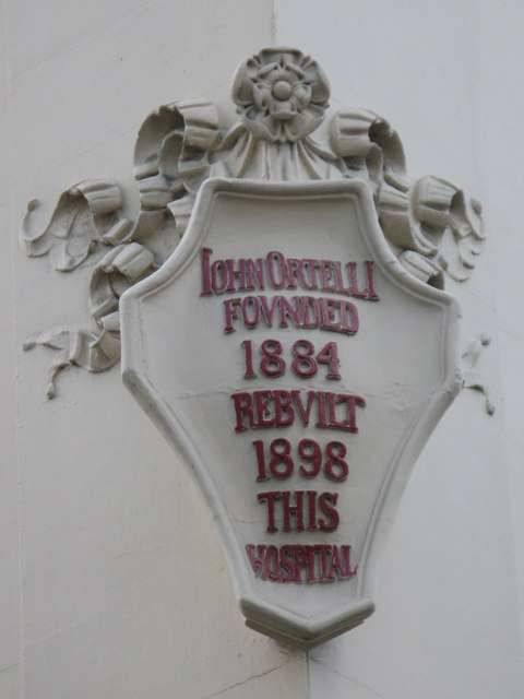 Plaque re John Ortelli, The Italian Hospital, Queen Square / Boswell Street, WC1