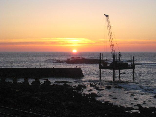 Sunset over Sennen Cove harbour