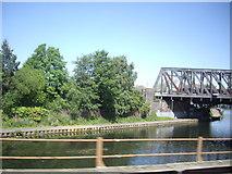 TL1998 : Main line railway bridge over the River Nene by Stanley Howe