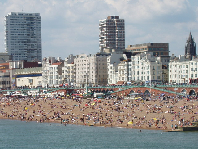 Crowded Brighton beach seen from Palace Pier