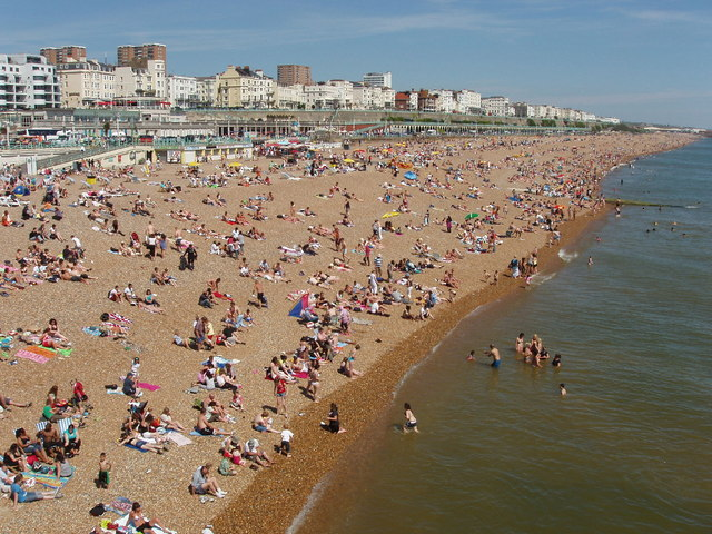 Crowded Brighton beach east of Palace Pier