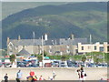 SH6115 : The back drop from the beach in Barmouth by Henry Spooner