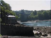 SH5571 : Carreg yr Halen at low water with Pont y Borth in the background by Eric Jones
