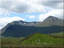 NN3049 : Distant mountains dominate the scene, taken from the A82 near Lochan na Stainge by James Denham