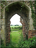 TM1685 : The ruined church of St Mary - south doorway by Evelyn Simak
