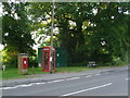 SU0100 : Colehill: postbox № BH21 32 and phone, Wimborne Road by Chris Downer
