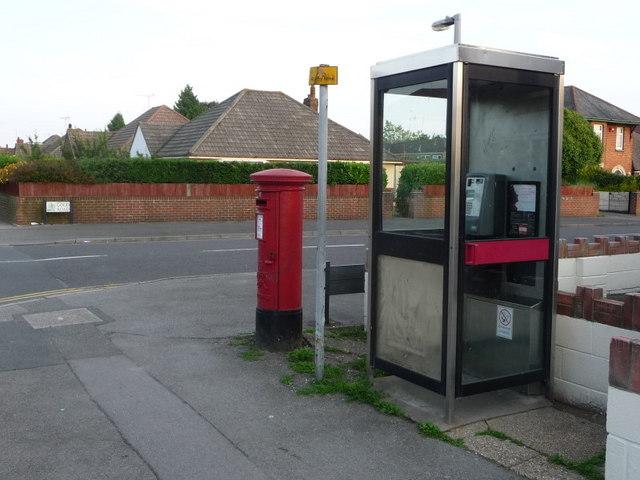 Alderney: postbox № BH12 165 and phone, Herbert Avenue