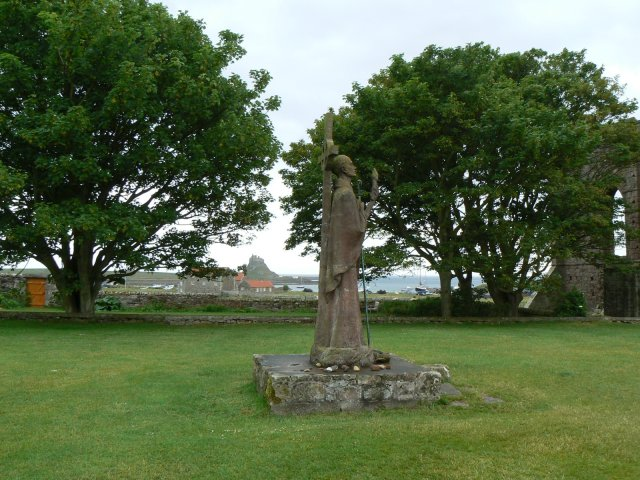 St Aidan with Lindisfarne Castle behind