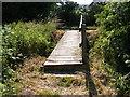 TM3570 : Footbridge on the footpath to The Mounts by Adrian Cable