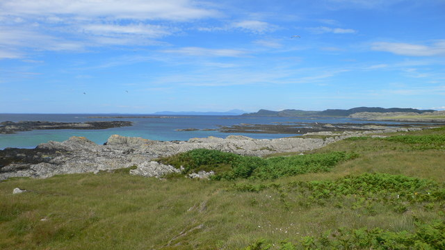 Looking north from the Ardskenish peninsula along the west coast of Colonsay with Mull on the horizon