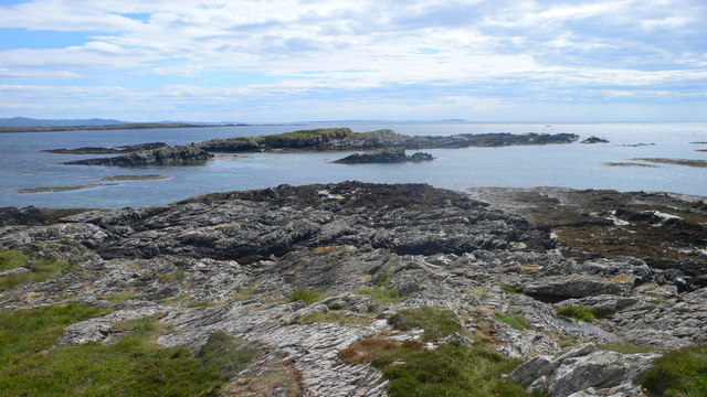 Looking on to Glas Eilean from the Ardskenish peninsula with the Mull of Oa on Islay in the distance