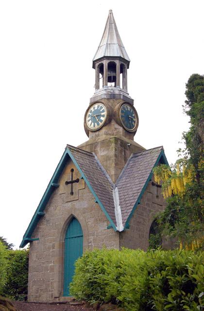 Clock tower in formal gardens, Cragside