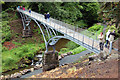 NU0702 : Visitors on the Iron Bridge, Cragside by Andy F