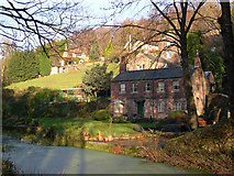 SK3354 : Cottages at side of Cromford Canal by Pete Wise