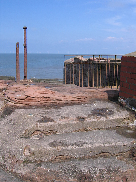 Steps and a bench mark at the north end of Hilbre Island