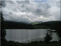 NY3404 : Loughrigg Tarn and the Langdale Pikes by Chris Heaton