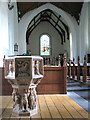TM3199 : The church of SS Peter & Paul - baptismal font by Evelyn Simak
