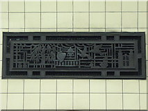 TQ3287 : Ventilation panel, Manor House tube station by Mike Quinn