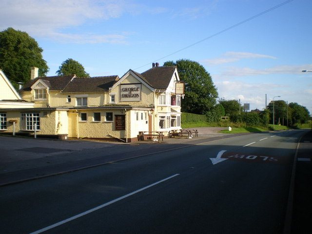 The George & Dragon and the Rough Close milepost