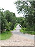 TM3193 : Church Road through the village of Hedenham by Evelyn Simak