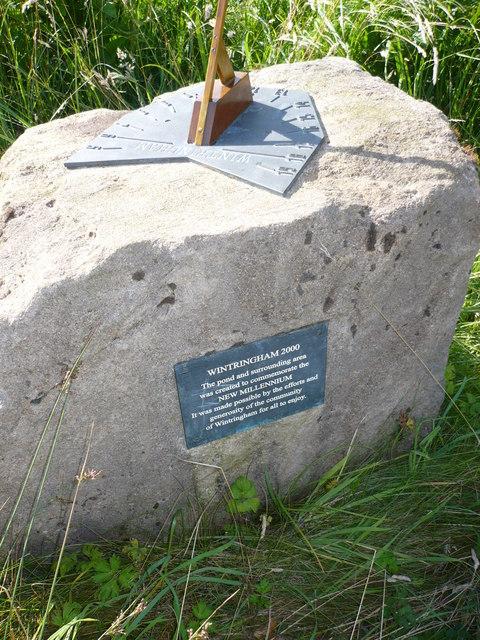 Sundial mounted on rock.