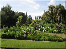 TQ2882 : Trees and flowers in Queen Mary's Gardens by Peter S