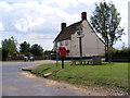 TM3958 : The Crown Public House, Snape Village Sign & The Green Postbox by Adrian Cable
