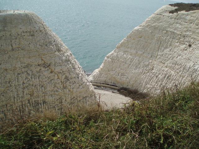 Path cut through cliffs