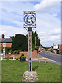 TM4360 : Knodishall Village Sign by Adrian Cable
