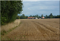 TL9357 : Field and woodland edge by Andrew Hill