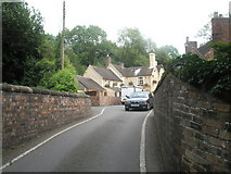 SJ6902 : Car coming from The Shakespeare Inn towards the narrow bridge by Basher Eyre