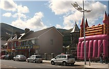 J3730 : Funworld and the dreaming spires of the Methodist Chapel and the Pink Bouncy Castle on Newcastle's Central Promenade by Eric Jones