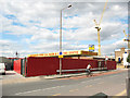 TQ3776 : Closed car wash, Greenwich High Road by Stephen Craven